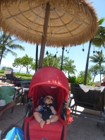 Siesta under an umbrella by the pool.
